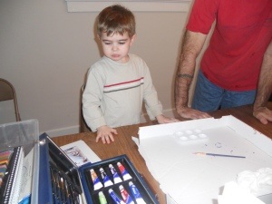 Philip looks at Daddy's paint set