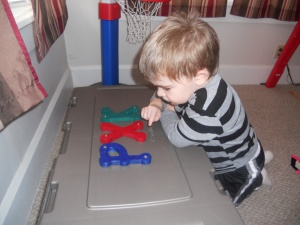 Admiring the letters that Daddy painted