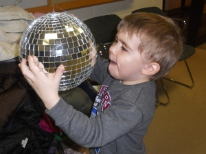 Not surprisingly, the shiny ball that spins was the highlight of the party for Philip