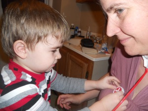 Philip has Mama use the stethoscope