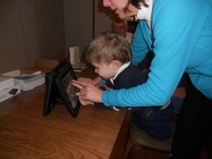 Philip's speech therapist guides him on the use of his new speech app