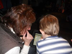 Mrs. T and Philip interacting with the iPad-and each other
