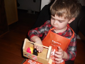 Wearing his apron, holding his tool box. The handle broke by the end of the evening :(