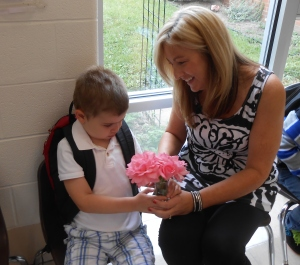 Philip gives his teacher roses from Grandma's house on the first day of school