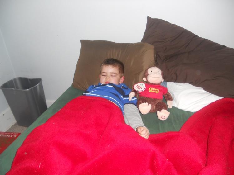 my little pumpkin sleeping next to a good little monkey