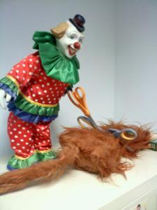 The recipient of my cat gift jumped when she opened the bag. She thought it was real hair. The equally scary clown was from the following year's party.